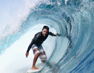 Pro-surfer Dennis Tihara surfing a tube at Teahupoo, Tahiti. | by cookiesound
