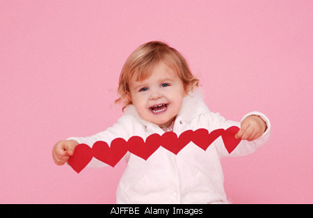 Two year old girl holding paper hearts | by five2b4u