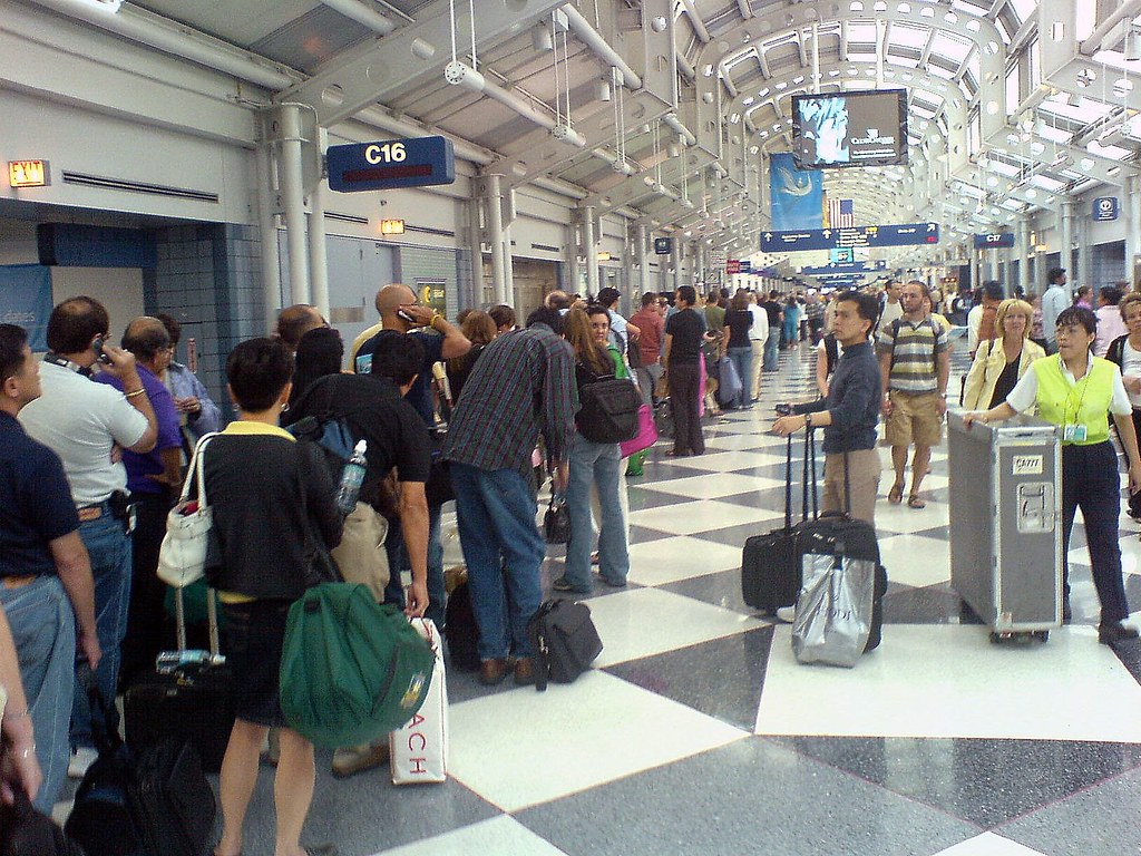 ... Line For United Airlines Customer Service Desk, Chicago Ou0027hare | By  Jaychl