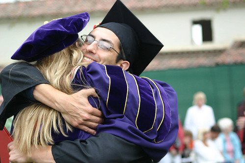 Student and Professor sharing a hug and congradulations | by California State University Channel Islands