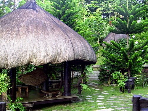 Ifugao garden ifugao garden huts is furnished with a for Small garden huts