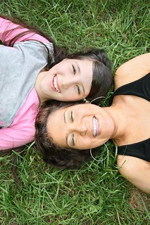 smiley mom and daughter on grass | by MyTudut