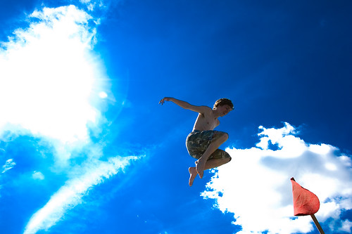 Jumping against the blue sky | by andjohan