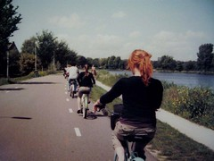 anna riding a bike behind a line of other bike riders | by tashalutek