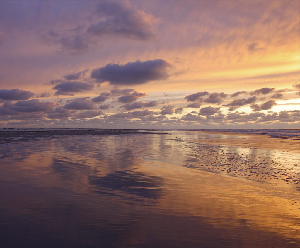 At The Beach With Sunset Color Water Reflections Sand Sky
