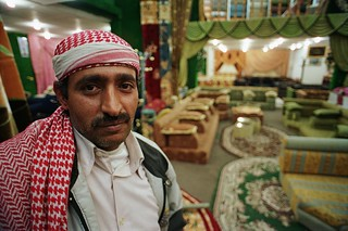 Carpet vendor in his store. Yemen. | by World Bank Photo Collection