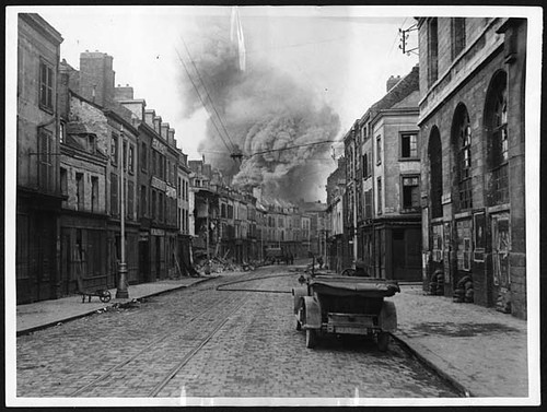 High explosive shell exploding in a building in Amiens | by National Library of Scotland