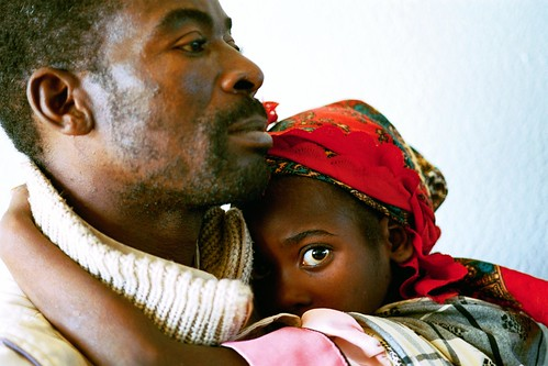 Man with child, Mozambique