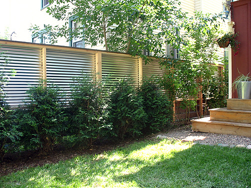 Fence With Reclaimed Lumber And Corrugated Steel Rolu