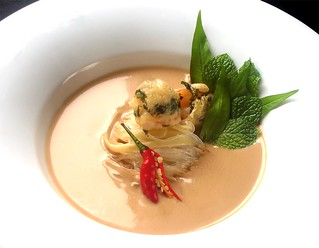 Fragrant Almond Laksa with noodles, fresh herbs and Oriental garden crispy prawns | by RecipeTaster