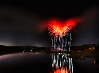 Heart of Satan - What it looks like when fireworks explode inside of a storm cloud over a river | by Stuck in Customs