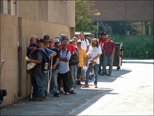 Soup Kitchen Waiting Line In The Inner City