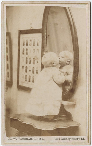 [Photograph of a baby standing in front of a mirror] | by Beinecke Library