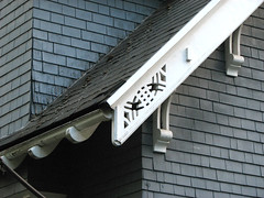 Elaborated rafter ends curved rafter tails decorative for Decorative rafter tails