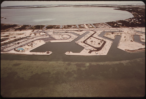 "Natural Waterways and Green Groves of Cudjoe Key Give Way to the Geometric Canals and Denuded Land of the Developers. This Is a Trailer Camp Called ""Venture Out."" It Is Typical of Land Development on the Florida Keys. 