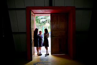 Student have a conversation in doorway | by World Bank Photo Collection