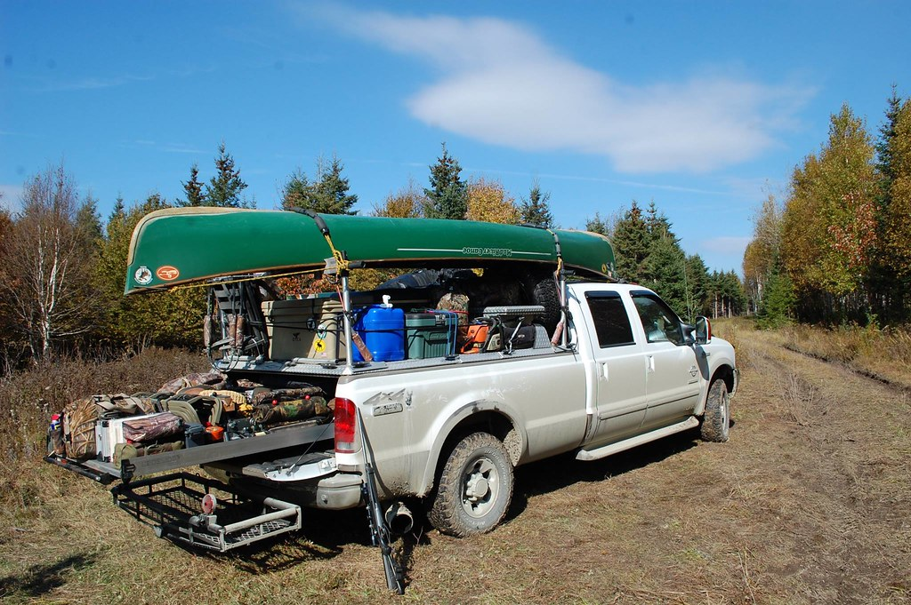 Camping And Hunting Gear Loaded On A Tonneau Cover Of Ford Super Duty