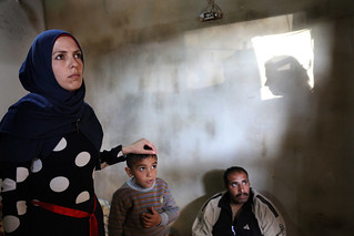 Ghada listening to a neighbor | by World Bank Photo Collection