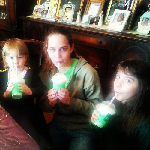 Virginia Mcguirk's granddaughters and great granddaughter drinking their shamrock shakes on st.  Patrick's day!