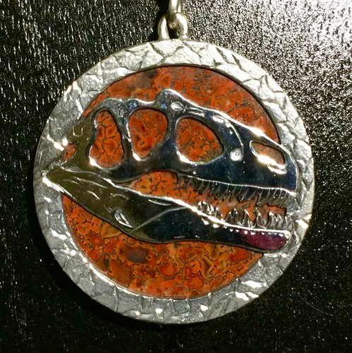 Hand engraved gem dinosaur bone pendant by Mark Anderson of Different Seasons Jewelry.