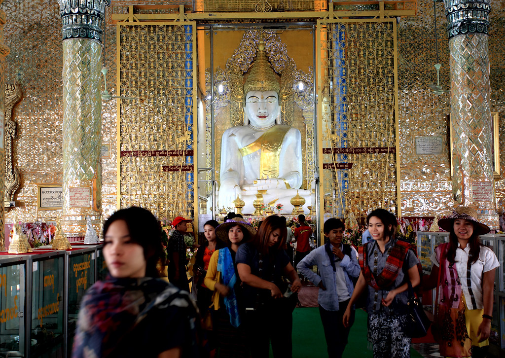 Worship At A Temple In Mandalay