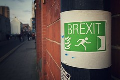 "Due to current events: Brexit & Education. Photo of a sticker on a sort of pipe immitating the typical green and white emergency exit sign, with a person running away from fire, only that instead of ""exit"" you can read ""brexit"". Photo: Paul Lloyd, Licence: CC by-nc-sa 2.0 Creative Commons Licence: Attribution + Noncommercial + ShareAlike"