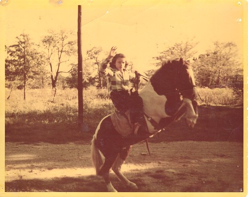 Me on brother's pony '51:  Her name was Blaze and my brother decided he didn't like to ride, so I took over.  She was a fine little pinto but I was growing too large for her, so within the year we sold her. | by aongarcia
