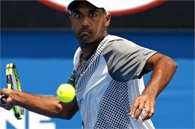 Melbourne : Rajeev Ram of the United States hits a forehand return to Kevin Anderson of South Africa during their first round match at the Australian Open tennis championships | by legend_news