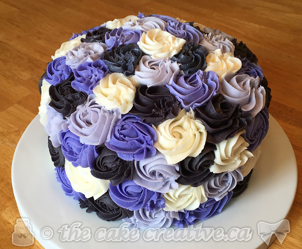 purple rosettes bridal shower cake by thecakecreative