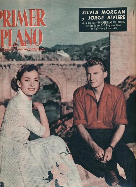 Silvia Morgan y Jorge (Georges) Riviere en el Puente de San Martín durante el rodaje de Un Americano en Toledo en 1957. Revista Primer Plano.