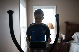 boy on elliptical machine 01-750 | by -kimcunningham