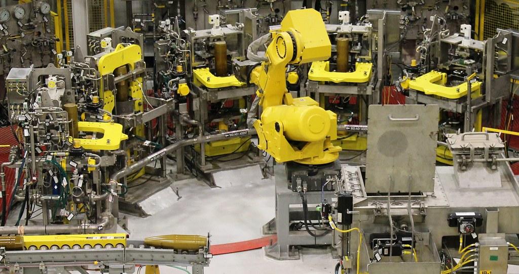 Image result for robot assembly line