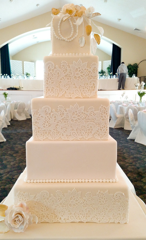 A five tier square wedding cake | This ivory, white and blus… | Flickr