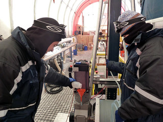 Zach and Shawntel adding oil to the winch gearbox | by U.S. Ice Drilling