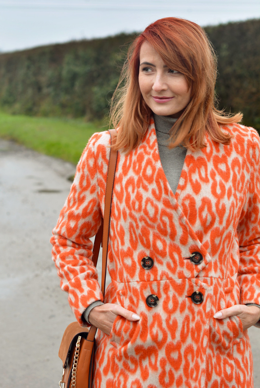 Orange animal print coat, grey roll neck | Not Dressed As Lamb