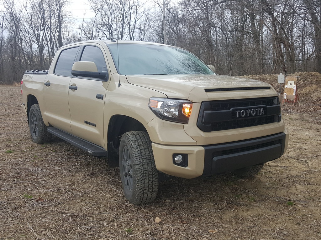 a heavy duty truck bed cover on a toyota tundra by diamondback truck covers