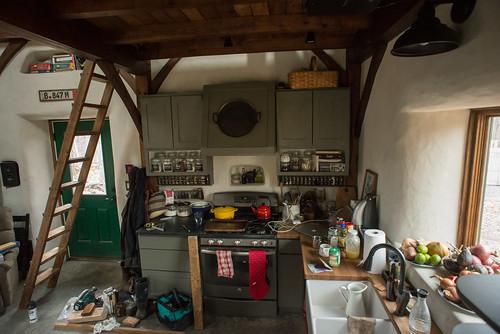 Messy Construction Kitchens : Messy straw bale cottage kitchen with loft ladder constru