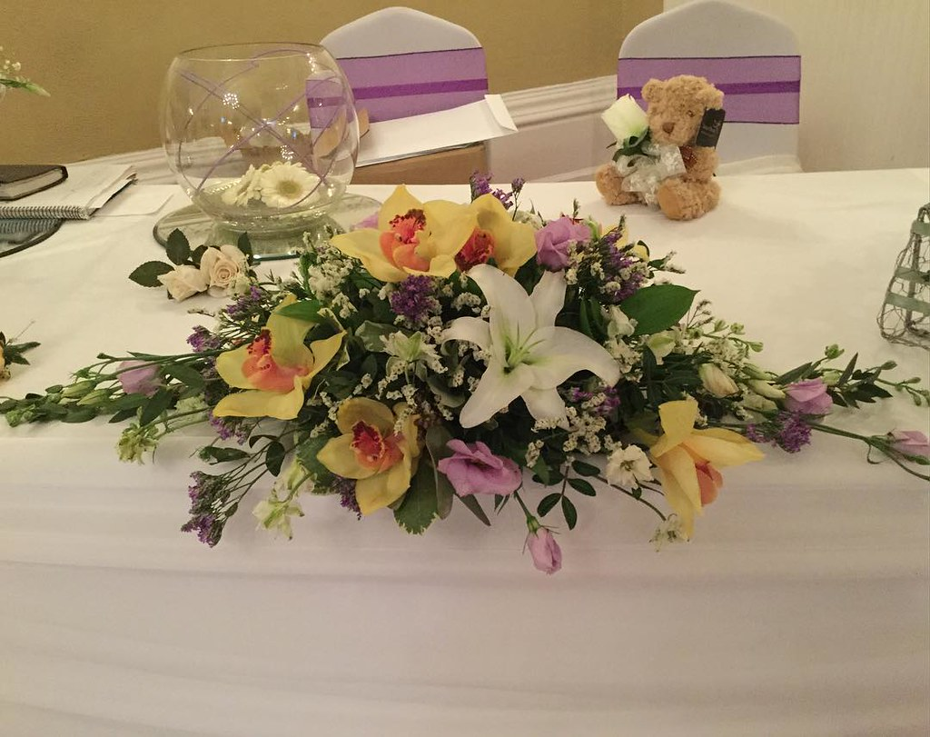 Wedding flowers toptable orchid lilies white lilac flickr wedding flowers toptable orchid lilies white lilac gold izmirmasajfo
