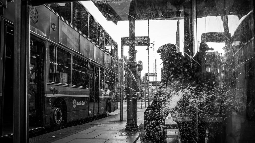 Waiting for the bus dublin ireland black and white street photography by
