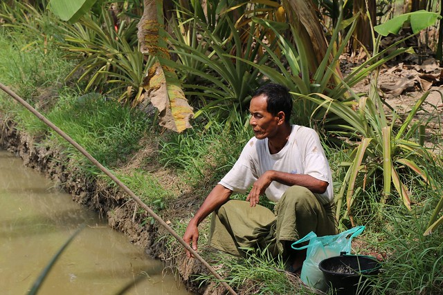 A farmer tending his small scale aquaculture pond, Ayeyarwady Delta, Myanmar. Photo by Toby Johnson