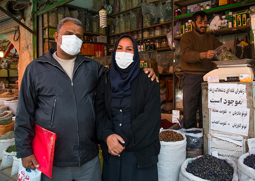 a couple wearing face masks to protect from h1n1 influenza in ganjali bazaar, Central County, Kerman, Iran | by Eric Lafforgue