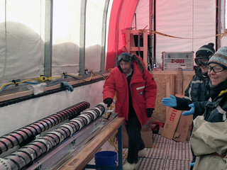 Eric Steig pushes the last core out of the drill barrel | by U.S. Ice Drilling