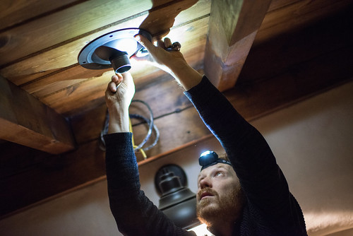 Tyler Screwing Projector Mounting Plate into Ceiling | by goingslowly