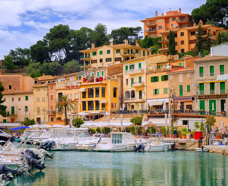 Motor boats and traditional houses in Puerto Soller, Mallorca, Spain