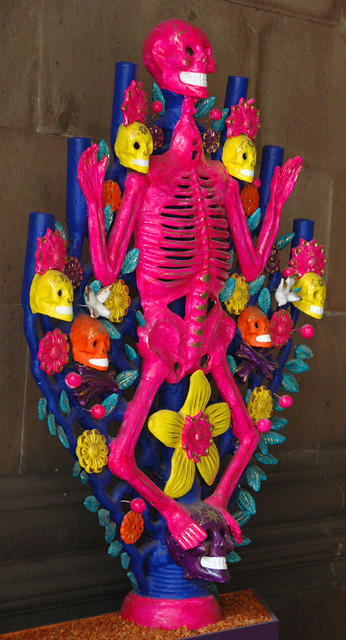 A hot pink skeleton made of paper maché sets the scene for the Mexican 'Day of the Dead' celebrations.