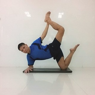 half bow pose in equilibrium onelegged revolved child's p