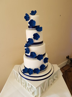 Four tiered navy blue fantasy flower wedding cake | by platypus1974