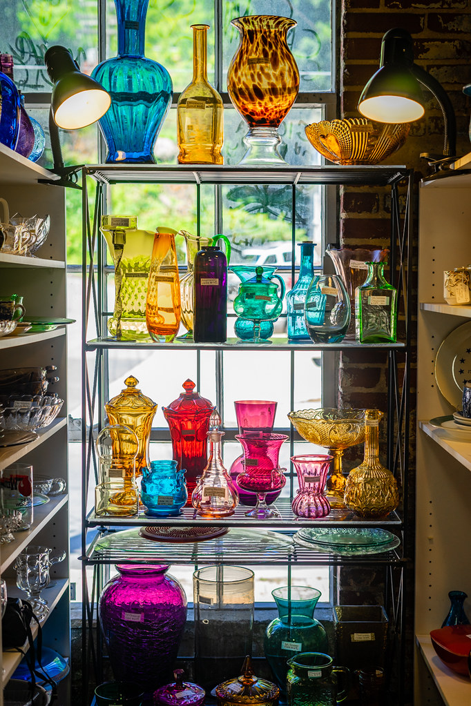 Colorful Antique Glassware Captures The Light Spilling In From Outside By John Brighenti