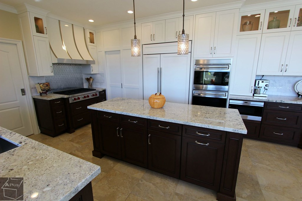... Kitchen Remodel With Custom Cabinets, Granite Countertops U0026 White And  Stainless Steel Striped Hood In