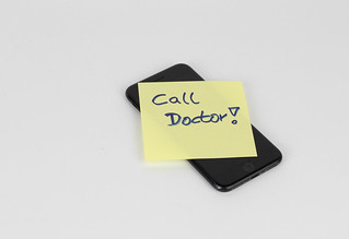 Call doctor on sticky note on cell phone | by wuestenigel